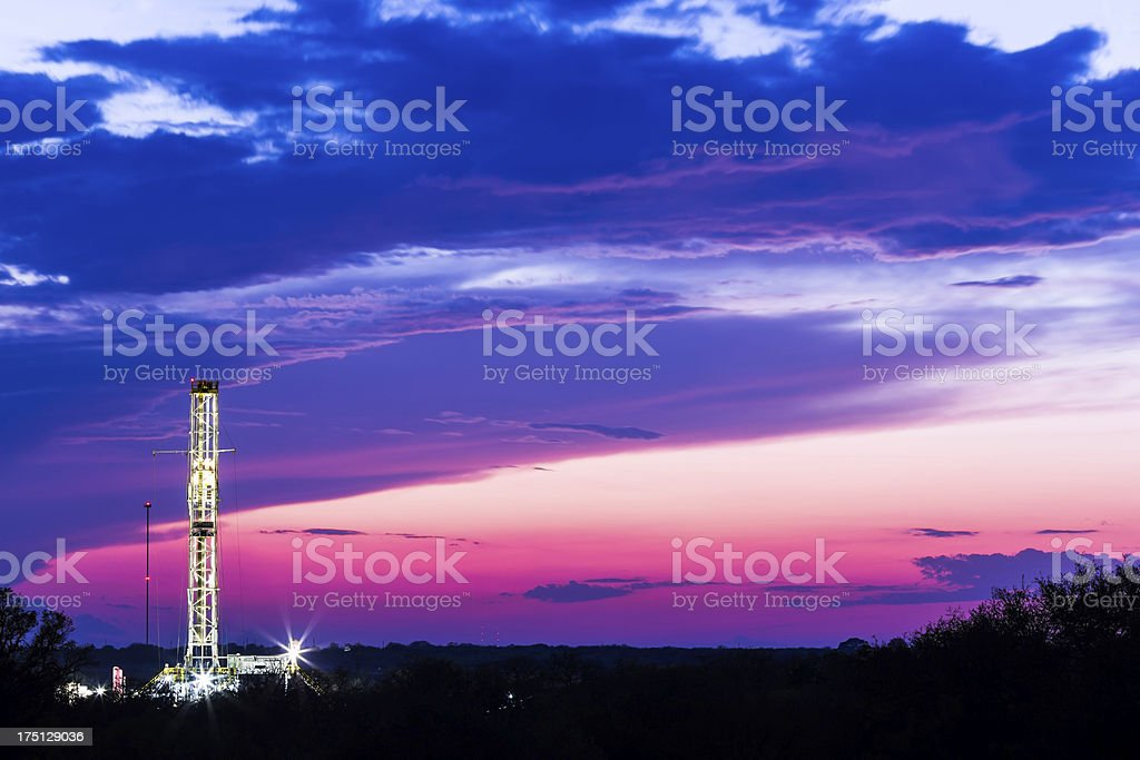 Shale oil rig at dawn. stock photo