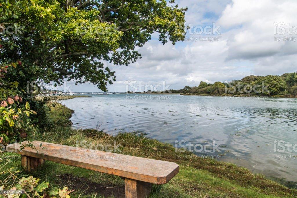 Shalfleet Quay bench seat stock photo