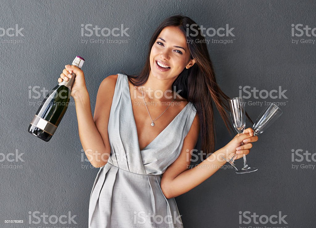 Shall we pop the cork on this champagne? stock photo