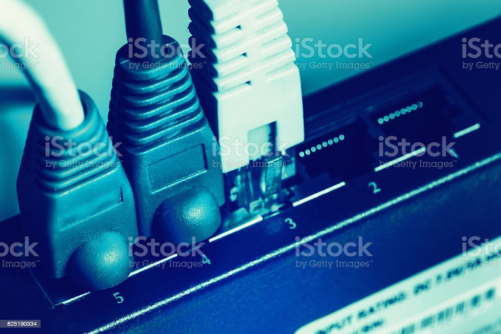shallow DOF blue network cable with connectors stock photo