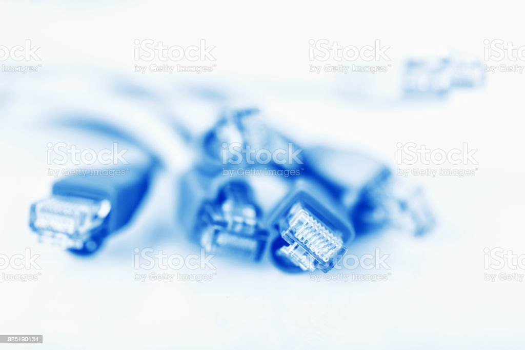 shallow DOF blue network cable with connectors. Selective focus. stock photo