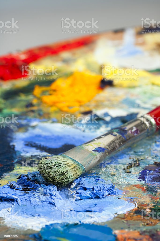 Shallow focus close-up of an artists paint palette and brush royalty-free stock photo