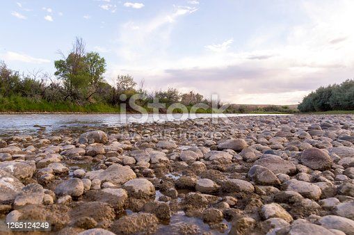 This shot shows the riverbed of the San Juan River in northwestern New Mexico, USA.  This shot was taken during a summer evening when the river was very shallow and many of the riverbed's rocks exposed.