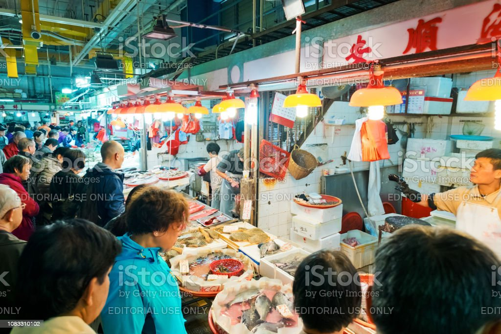 Sham Shui Po Market with fresh vegetable and seafood. It's one of the largest food markets in Hong Kong. stock photo