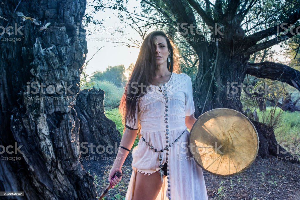 Shaman woman drumming stock photo