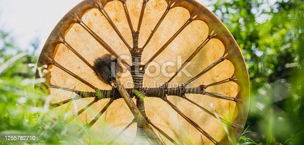 Shamanic drum in grass.