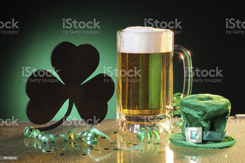 Shamrock and Beer to Celebrate Saint Patrick's Day royalty-free stock photo