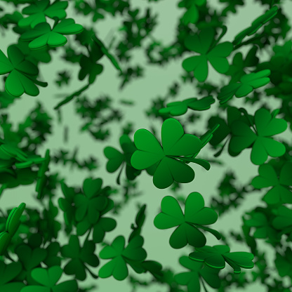 Shamrock and clover on a green background