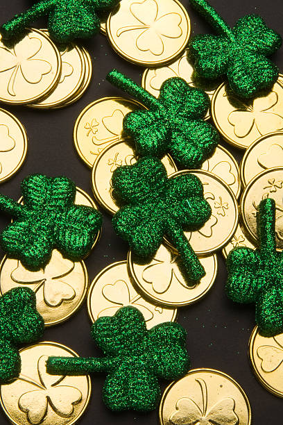 shamrocks and gold coins - luck of the irish stock photos and pictures