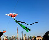 The Chinese tradition Peking opera styles of makeup kite in the landmark of shanghai.  All of the patterns on the kite without copyright/trademark .