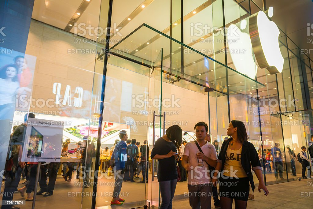 Shanghai Apple Store customers on Nanjing Road shopping street China stock photo