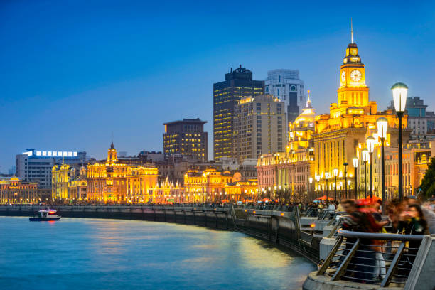 Shanghai at night Shanghai at night. Located in The Bund (Waitan). It is a waterfront area in central Shanghai, one of the most famous tourist destinations in Shanghai, China. the bund stock pictures, royalty-free photos & images