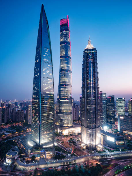 Shanghai Big Three Shanghai pudong CBD, top three high buildings, The middle building is the shanghai which is the highest building in China pudong stock pictures, royalty-free photos & images