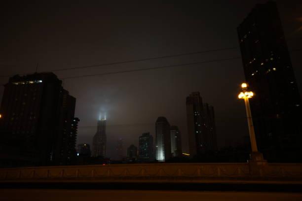 Shanghai buildings under cloudy skies at night stock photo