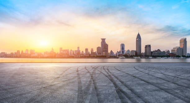 Shanghai bund skyline and empty asphalt road at sunset Shanghai bund skyline and empty asphalt road ground at sunset huangpu river stock pictures, royalty-free photos & images