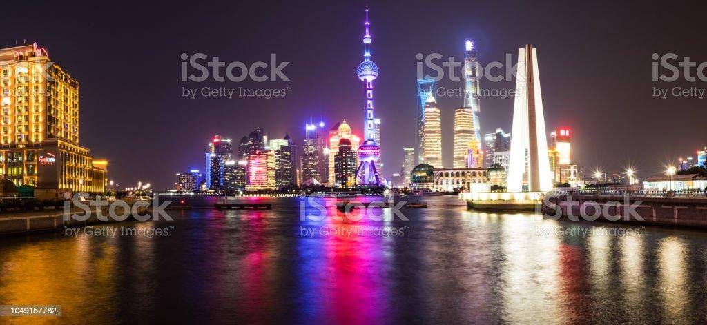 Shanghai, China - December 25 2017: Shanghai Skyline at night - long exposure - bridge looking at tv oriental building stock photo