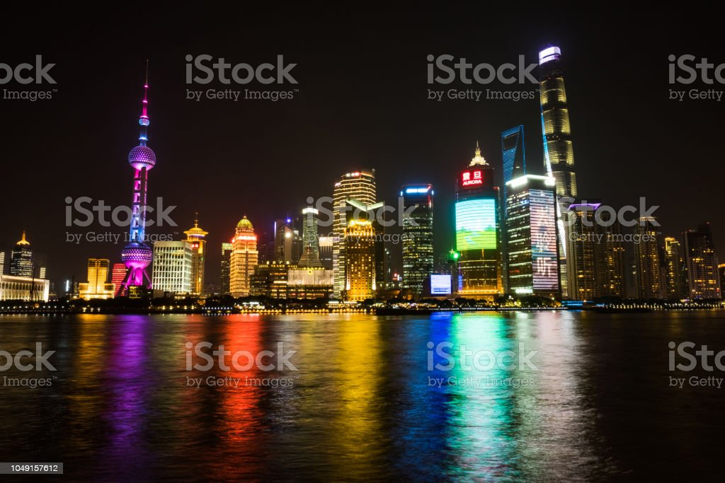 Shanghai, China - December 25 2017: Shanghai Skyline at night - long exposure with color blur on the yellow river stock photo