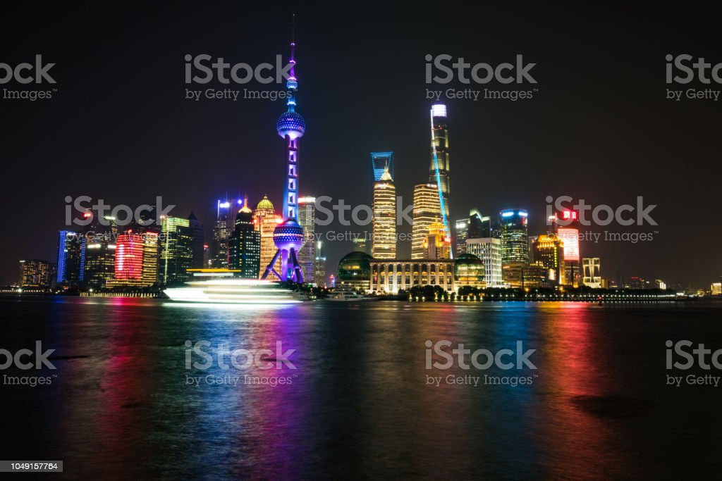 Shanghai, China - December 25 2017: Shanghai Skyline at night - long exposure with boat blurred stock photo
