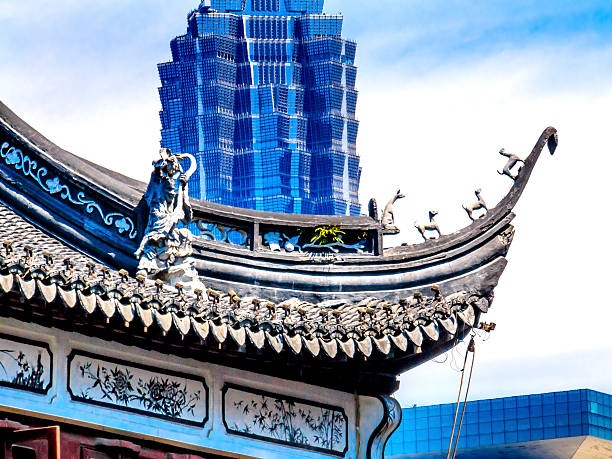 Shanghai China Old New Jin Mao Tower and Yuyuan Garden Jin Mao Tower, third highest building, from Yuyuan Garden, Old Town, Shanghai China jin mao tower stock pictures, royalty-free photos & images
