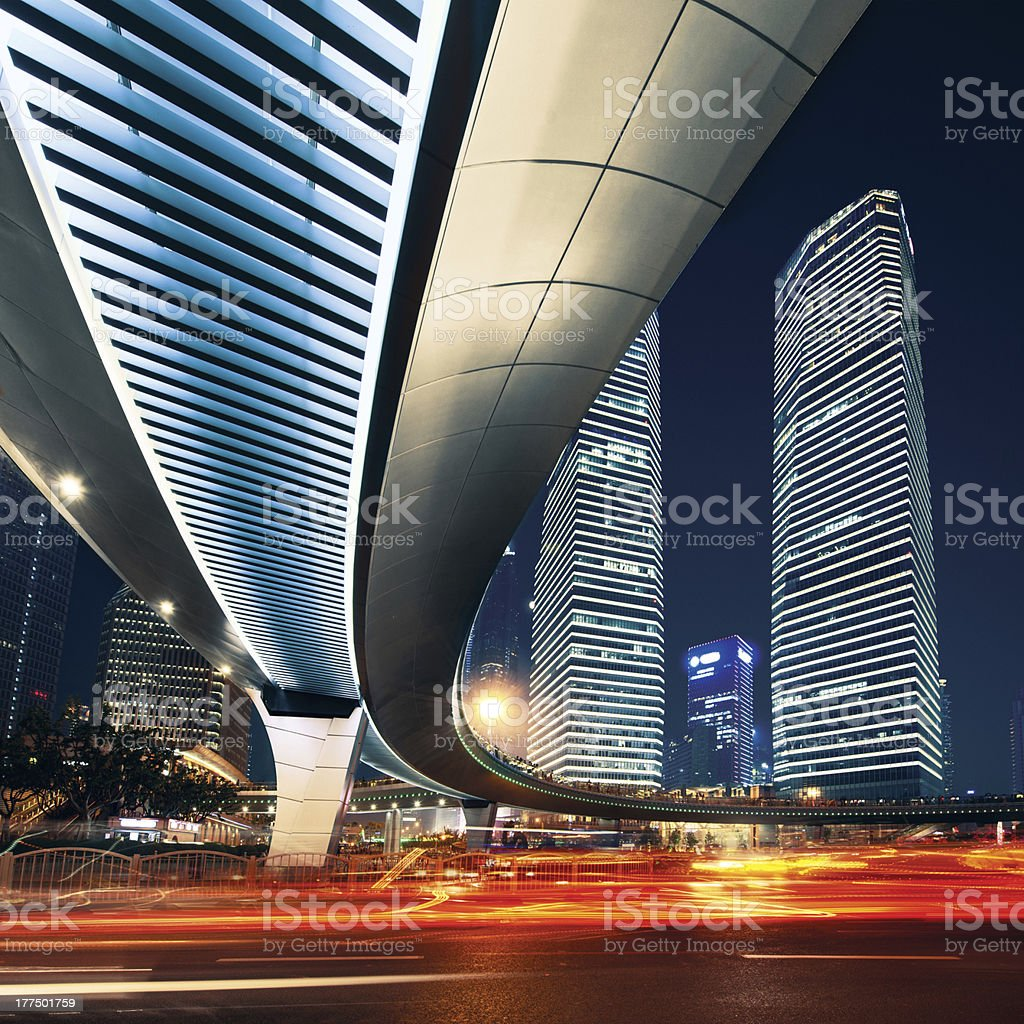 Shanghai City at sunset with light trails stock photo