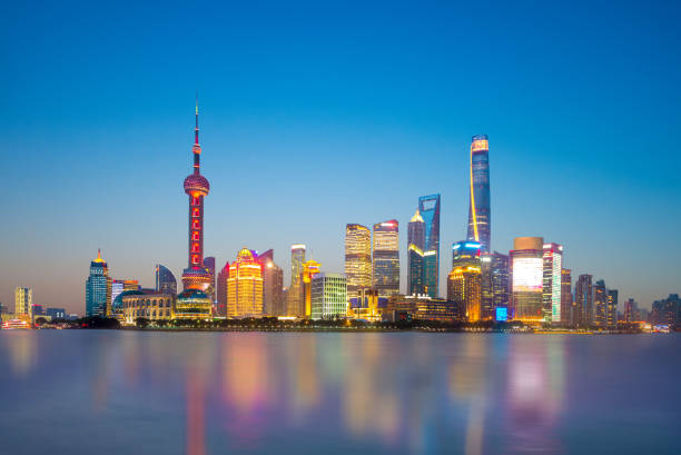 shanghai city in china skyline of shanghai by the huangpu river the bund stock pictures, royalty-free photos & images