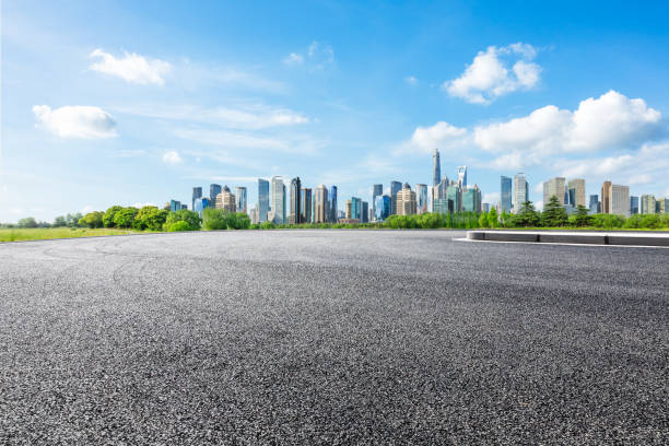 Cтоковое фото Shanghai city skyline and famous landmark buildings with asphalt road ground
