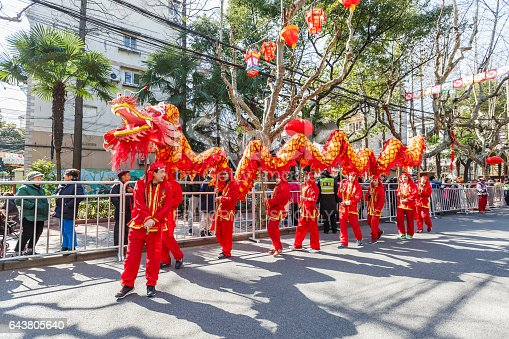 Shanghai,China - on February 11,2017:Dragon and lion parade dance show in the Chinese Lantern Festival,in the city streets of Shanghai.