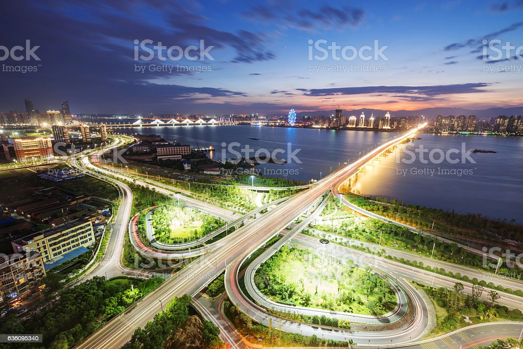 shanghai interchange overpass and elevated road in nightfall stock photo