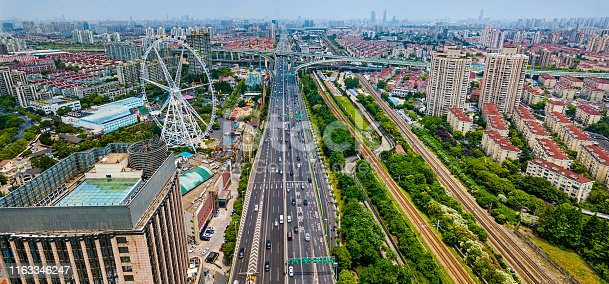 Panoramic view of Shanghai Jinjiang Park area, elevated highway interchange and Ferris Wheel