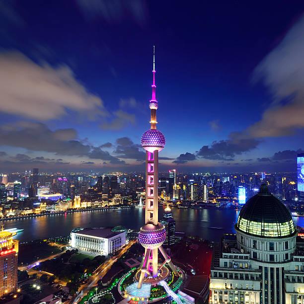 Shanghai Landmark at Night Shanghai landmark, Oriental Pearl Tower at night, China. oriental pearl tower shanghai stock pictures, royalty-free photos & images