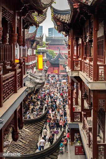 People at Yuyuan Market in Old City of Shanghai, China. The market grew up around Yuyuan Gardens and City God Temple in 19th century during the Qing Dynasty.