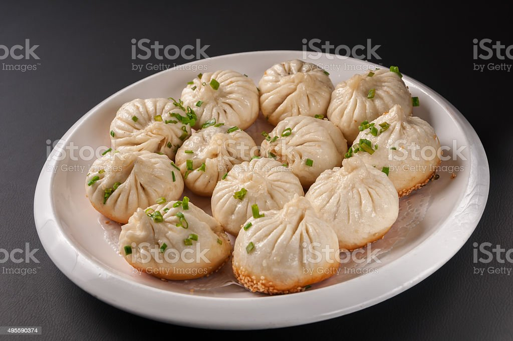 Shanghai Pan-Fried Baozi Stuffed with Pork stock photo