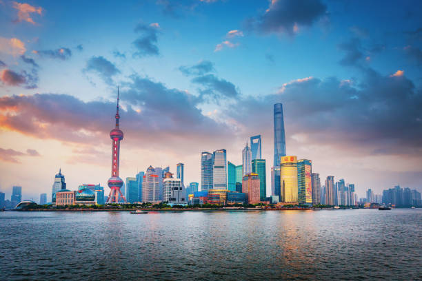 Shanghai Pudong Beautiful Sunset Twilight China Beautiful sunset twilight over the Shanghai Skyline view to Pudong at Dusk Panoramic view over Huangpu River to the famous skyscrapers and Oriental Pearl Tower. Shanghai, Pudong, China, Asia oriental pearl tower shanghai stock pictures, royalty-free photos & images
