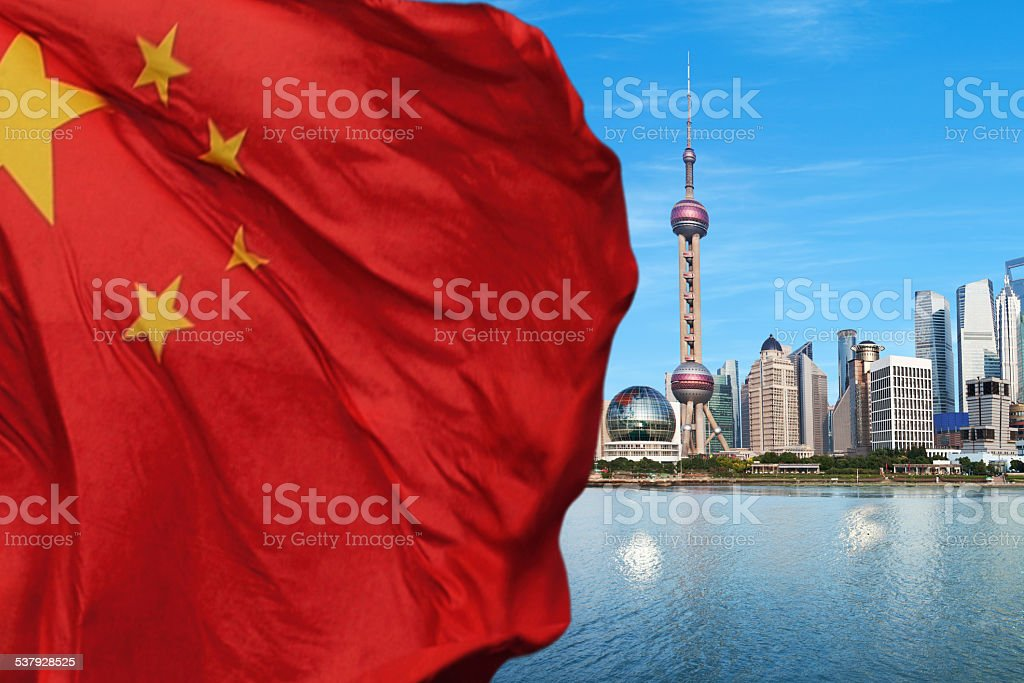 Shanghai Pudong with Chinese flag stock photo