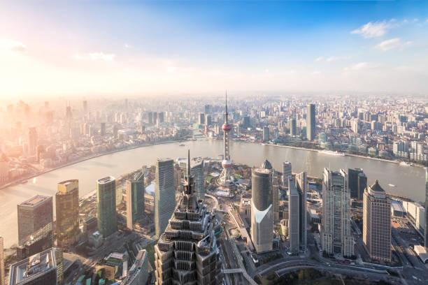 Shanghai skyline and cityscape at sunset stock photo