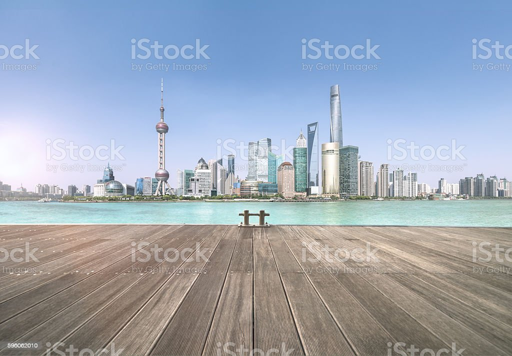 Shanghai skyline and cityscape with empty wood platform royalty-free stock photo