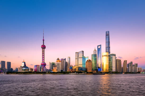 Shanghai skyline at dusk Shanghai, China - East Asia, Urban Skyline, The Bund, Oriental Pearl Tower - Shanghai oriental pearl tower shanghai stock pictures, royalty-free photos & images