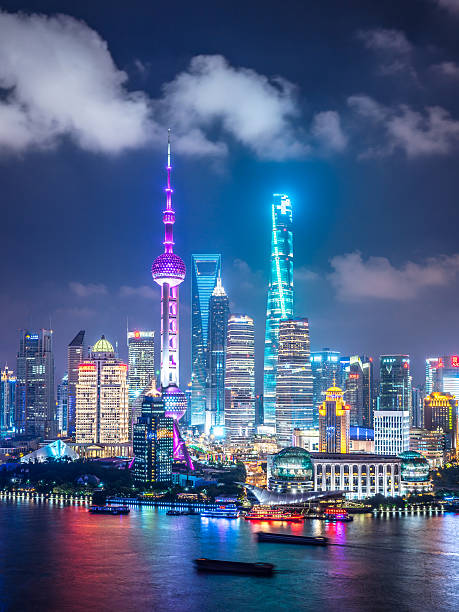 Shanghai Skyline at Night Elevated view of Shanghai skyline at night. jin mao tower stock pictures, royalty-free photos & images