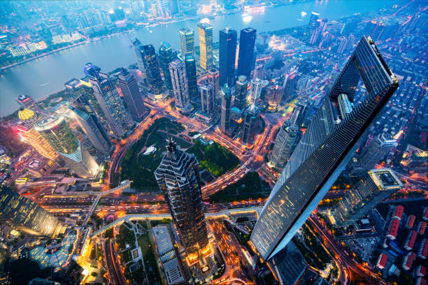 Shanghai Skyline at Night Wide angle view of the waterfront Lujiazui Financial District at night. shanghai stock pictures, royalty-free photos & images