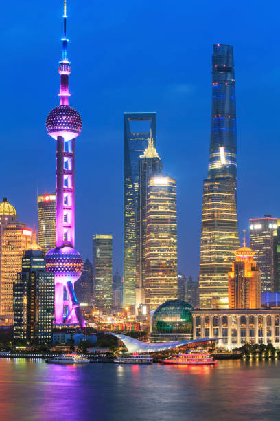 Shanghai Skyline at Night Wide angle view of the waterfront Lujiazui Financial District at night. jin mao tower stock pictures, royalty-free photos & images