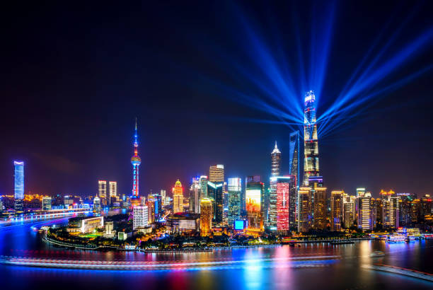 Shanghai skyline at night with spotlights Shanghai Tower open the spotlights welcome CHINA INTERNATIONAL IMPORT EXPO the bund stock pictures, royalty-free photos & images