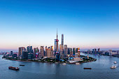 Wide angle view of the waterfront Lujiazui Financial District and the bund at sunset.