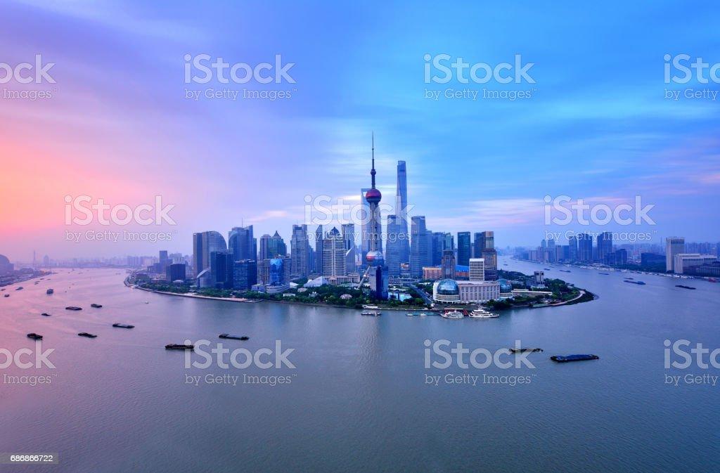 Shanghai Skyline in Dramatic Sky at Sunrise stock photo