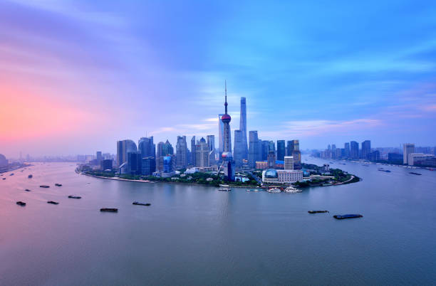 Shanghai Skyline in Dramatic Sky at Sunrise Shanghai panoramic skyline in the dramatic sky at sunrise, Shanghai, China. huangpu river stock pictures, royalty-free photos & images