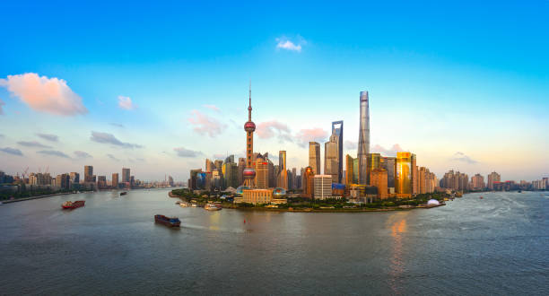 Shanghai skyline in sunset Shanghai skyline in sunset huangpu river stock pictures, royalty-free photos & images