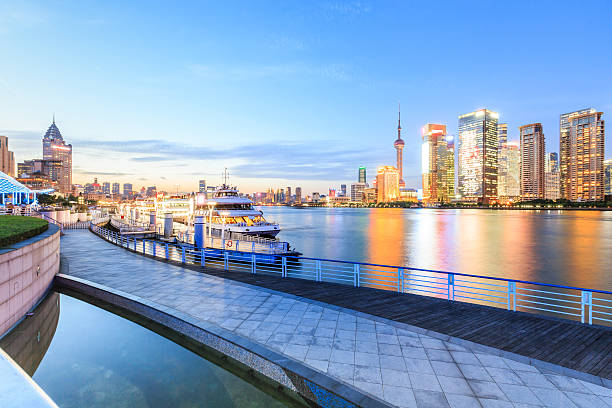 Shanghai skyline on the Huangpu River at night Shanghai skyline on the Huangpu River at night,China huangpu river stock pictures, royalty-free photos & images