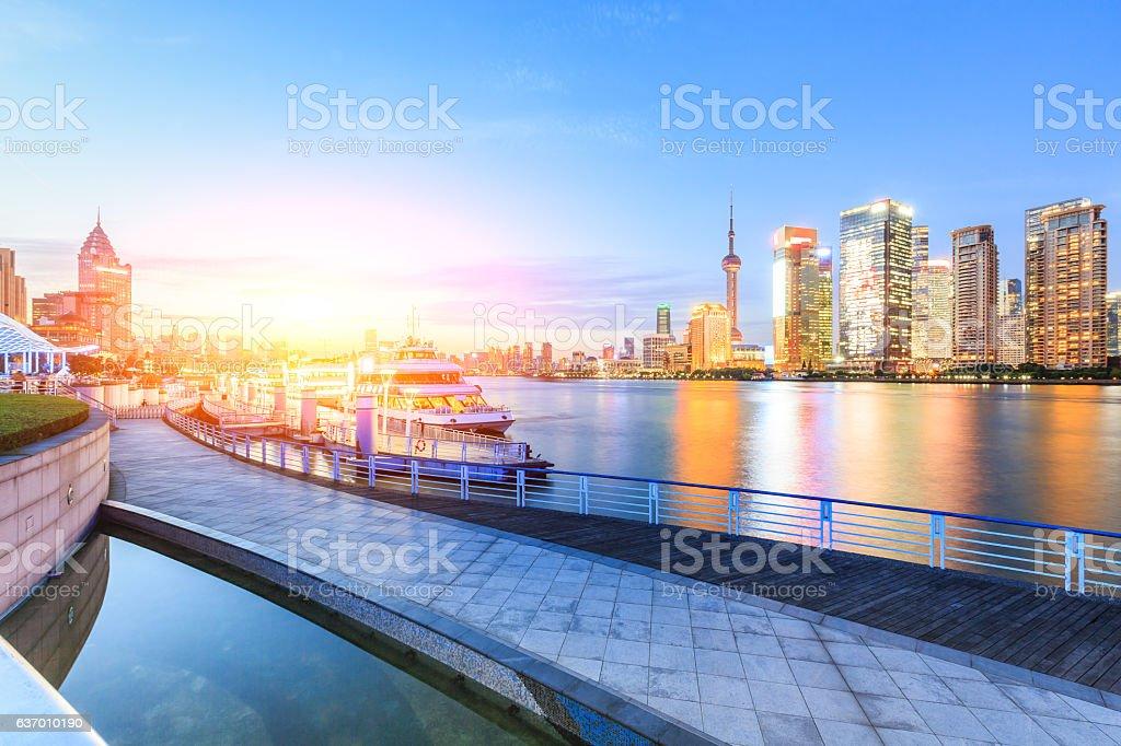 Shanghai skyline on the Huangpu River at sunset stock photo