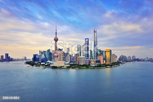 Shanghai skyline panoramic in the dramatic sky at sunset.