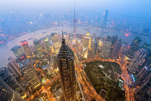 Shanghai Skyline Shanghail, China - Oct 13, 2015: Elevated view of  Lujiazui district in Shanghai, in Mao Tower in the foreground. Lujiazui has been developed specifically as a new financial district of Shanghai.  bank of china stock pictures, royalty-free photos & images