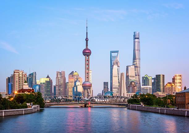 Shanghai Skyline Shanghai Skyline at dusk. huangpu river stock pictures, royalty-free photos & images